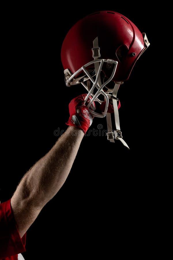 Jugador de f?tbol americano que anima con el brazo para arriba imagen de archivo libre de regalías