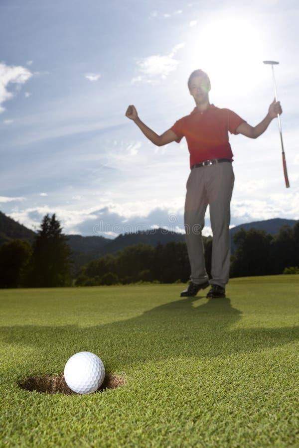 Jugador de golf feliz. foto de archivo libre de regalías