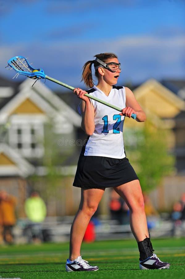Jugador de la muchacha del lacrosse fotos de archivo