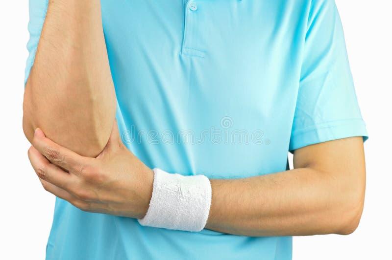 Jugador de tenis con lesión del codo imagenes de archivo
