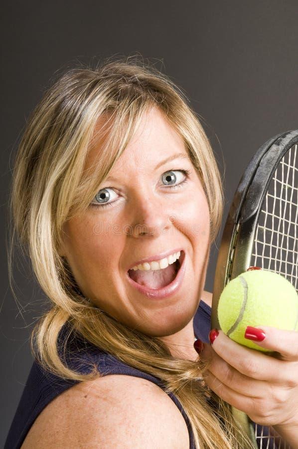 Jugador de tenis de la mujer feliz fotografía de archivo