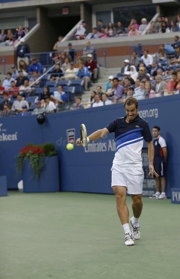 Jugador de tenis profesional Richard Gasquet durante su partido de semifinal en el US Open 2013 contra Rafael Nadal imagen de archivo libre de regalías