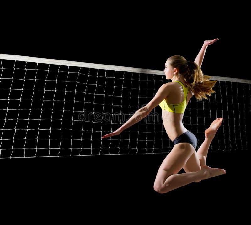 Jugador de voleibol de playa de la mujer con la versión neta foto de archivo libre de regalías