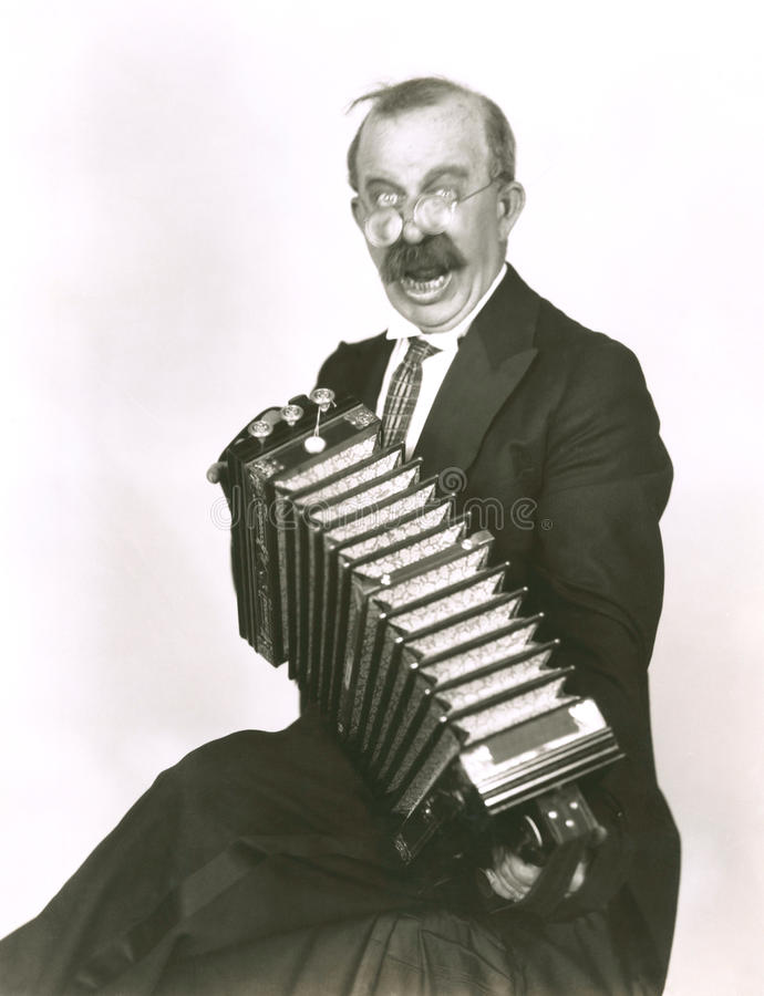 Jugador del acordeón imagenes de archivo