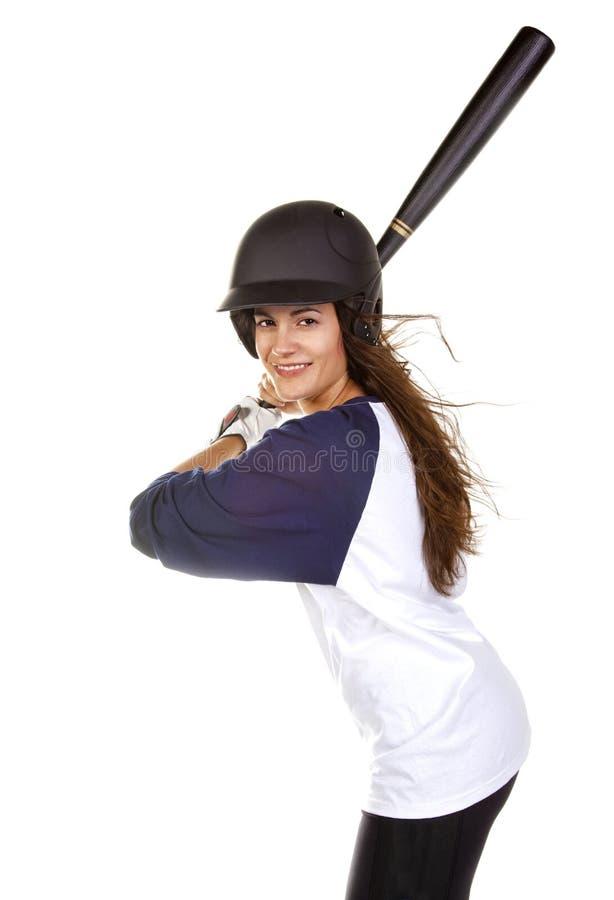 Jugador del béisbol o de beísbol con pelota blanda de la mujer imagenes de archivo