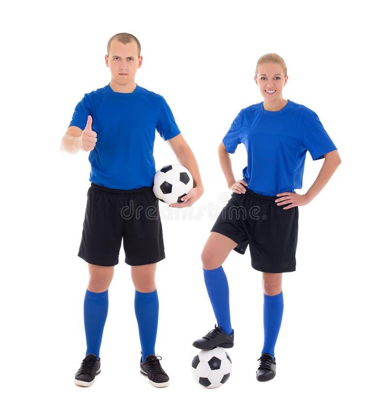 Jugadores de fútbol de sexo masculino y de sexo femenino con bolas en el fondo blanco foto de archivo libre de regalías