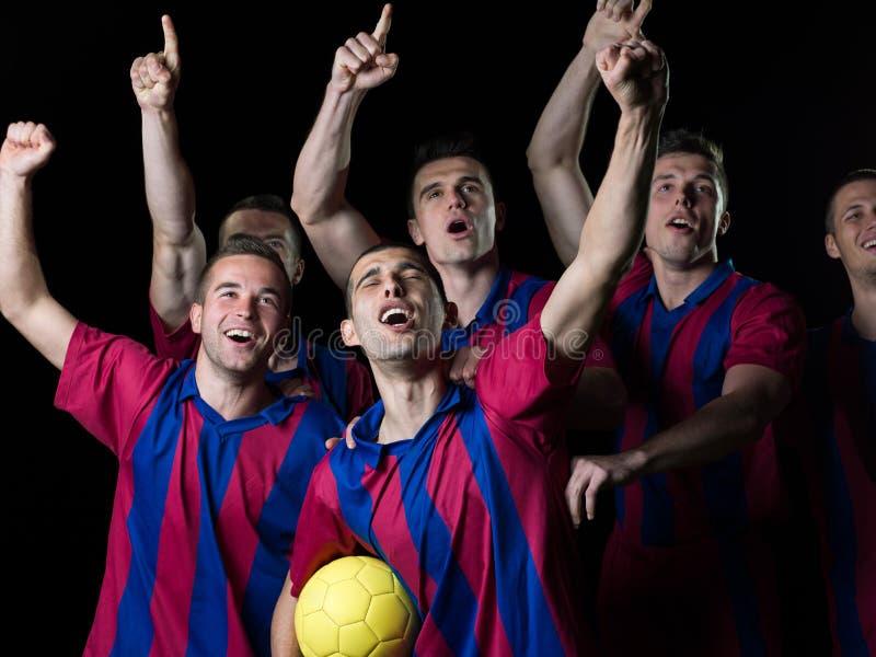 Jugadores de fútbol que celebran la victoria fotos de archivo