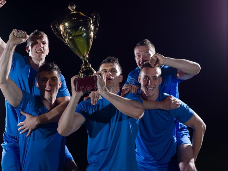 Jugadores de fútbol que celebran la victoria imágenes de archivo libres de regalías