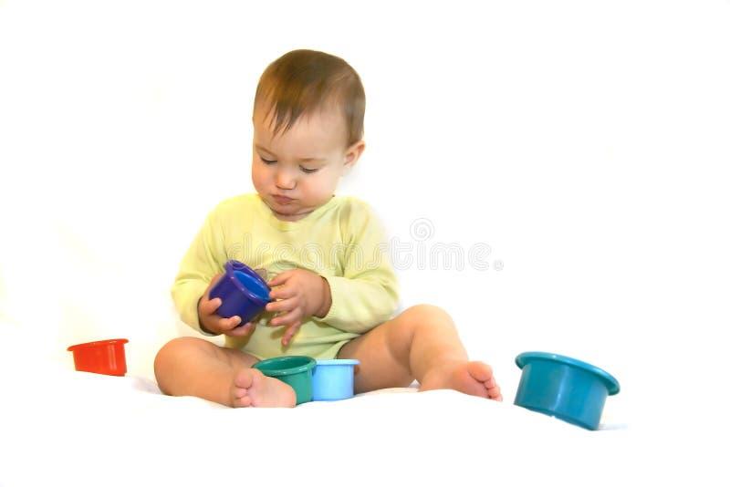 Jugar al bebé sobre blanco foto de archivo libre de regalías