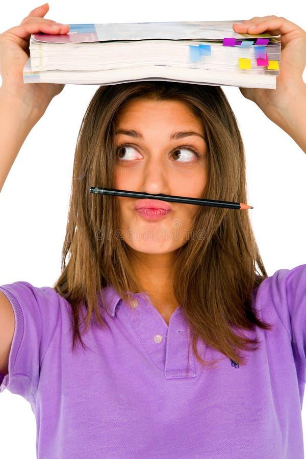 Jugendgir balancierender Bleistift auf ihrer Lippe stockfotos