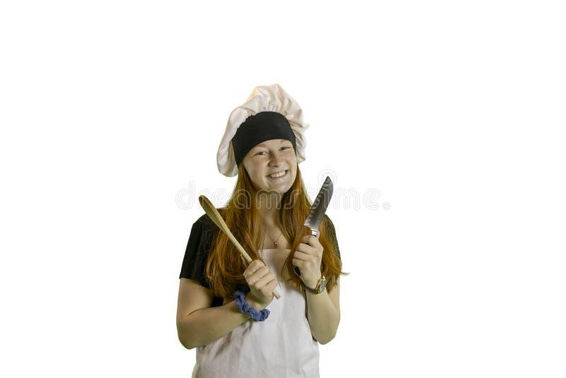 Jugendlich Chef mit Messer und Löffel lizenzfreies stockfoto