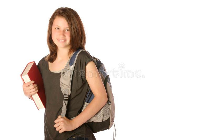 Jugendlich, ein Buch und einen Rucksack tragend lizenzfreies stockbild