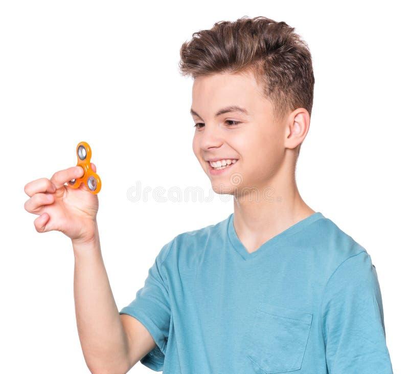 Jugendlich Junge mit Spinner lizenzfreie stockfotos