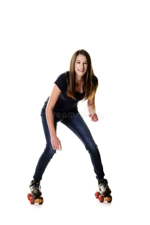 Jugendlich Mädchen, das zum Rollschuh versucht lizenzfreies stockbild