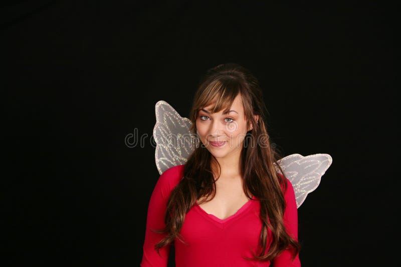 Jugendlich Mädchen in den feenhaften Flügeln stockbild