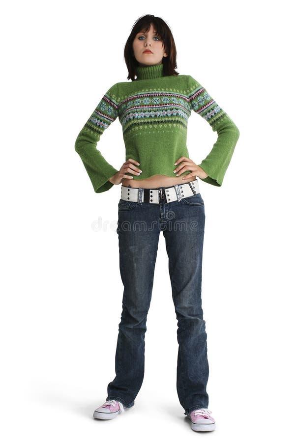 Jugendlich Mädchen in den Jeans und in der Strickjacke stockfoto