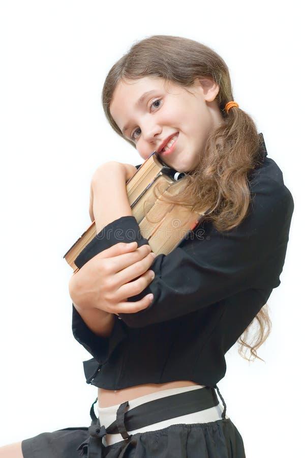 Jugendlich Mädchen des Kursteilnehmers mit Büchern stockfotografie
