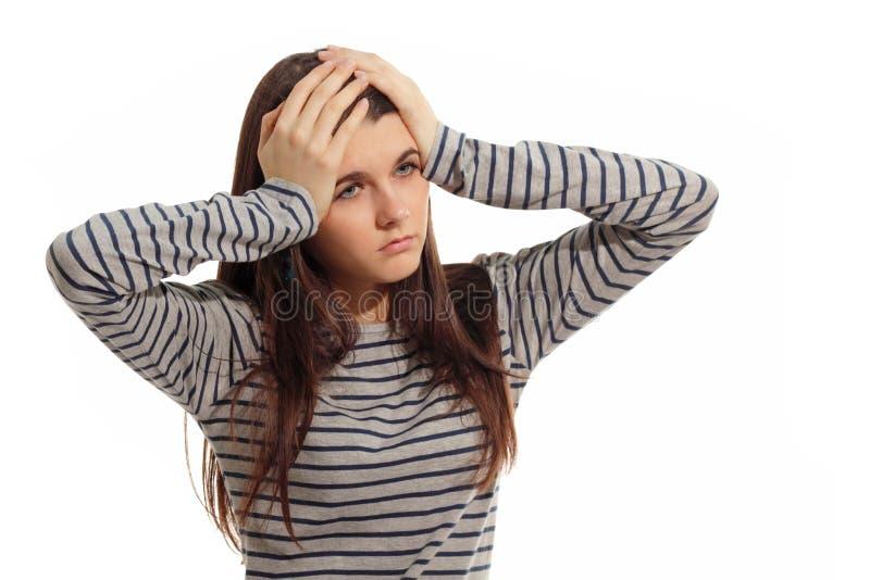 Jugendlich Mädchen mit Problemkopfschmerzentiefstand lizenzfreie stockfotografie