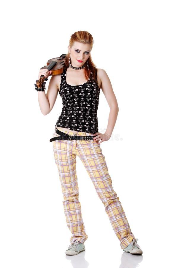 Jugendlich Punkmädchenholdinggeige. stockfotografie