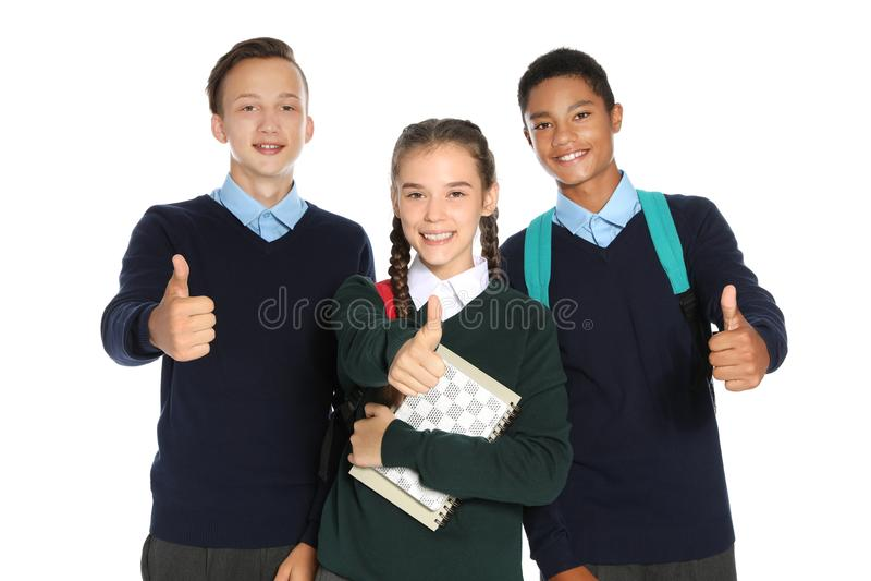 Jugendliche in der stilvollen Schuluniform stockbilder