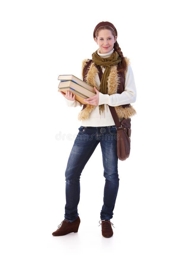 Jugendliche mit den Büchern, die zur Schule gehen stockbild