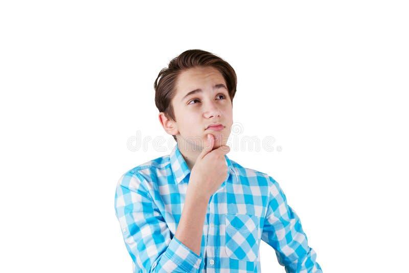 Jugendlicher, der über etwas zweifelhaft ist stockfoto