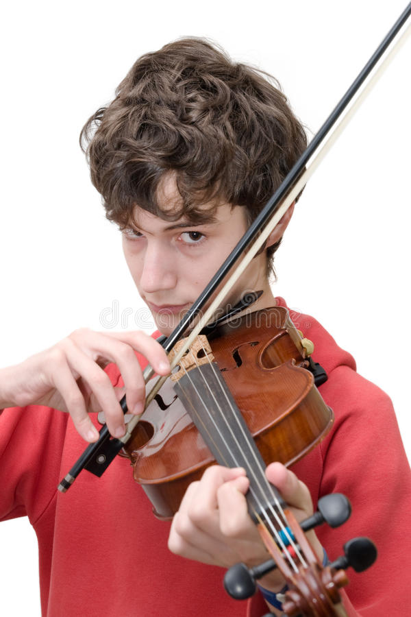 Jugendlicher, der Violine spielt lizenzfreie stockfotografie