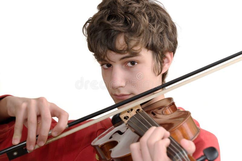 Jugendlicher, der Violine spielt stockbilder