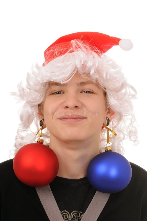 Jugendlicher mit Weihnachtsdekoration stockbild