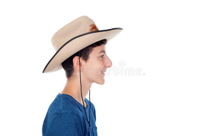 Jugendlichjunge mit einem Cowboyhut stockfotos