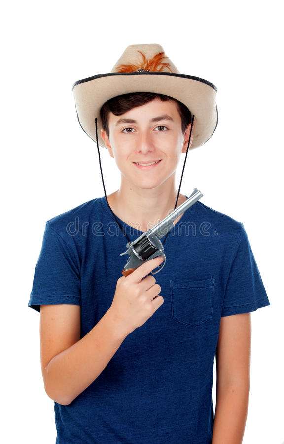 Jugendlichjunge mit einem Cowboyhut und einem Gewehr lizenzfreies stockbild