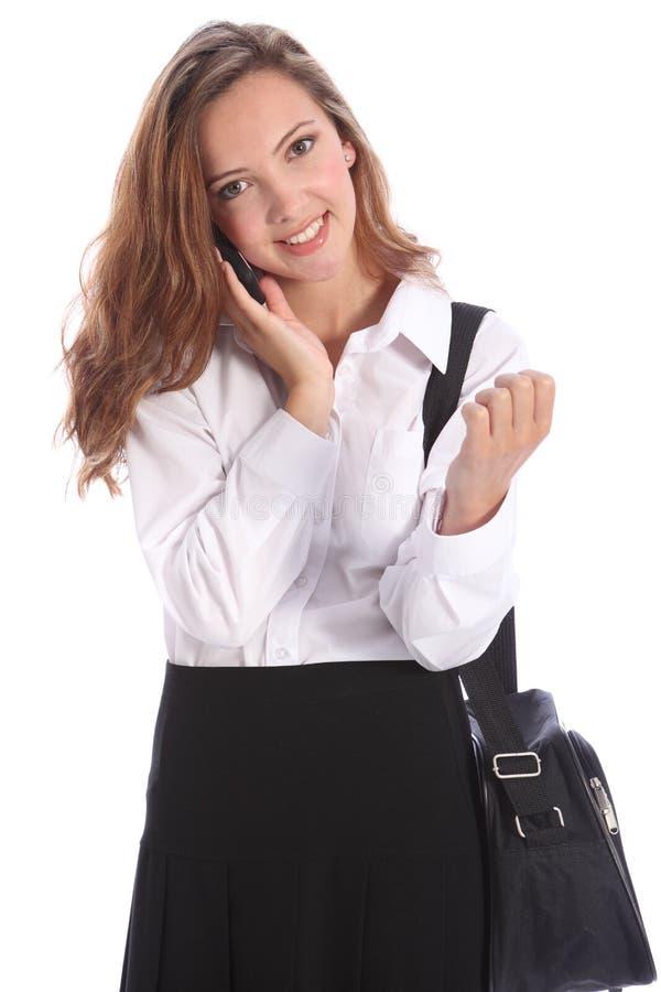 Jugendschulemädchen im Handygespräch lizenzfreie stockfotos