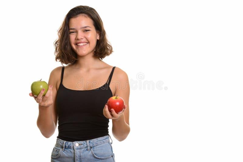 Juger de sourire de jeune adolescente caucasienne heureuse rouge et vert image libre de droits