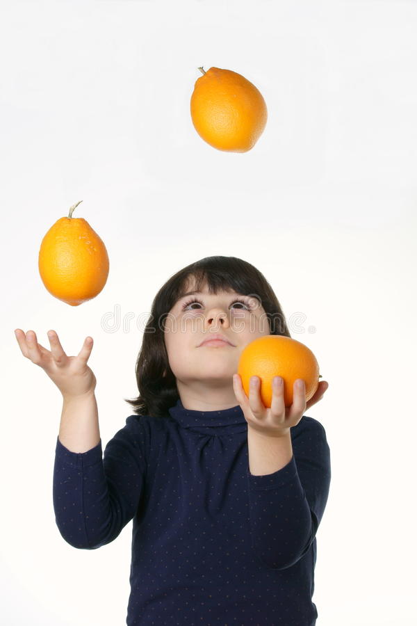 Juggler child with oranges stock images
