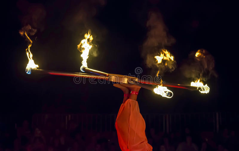 Juggler in the circus. Juggling with fire royalty free stock image