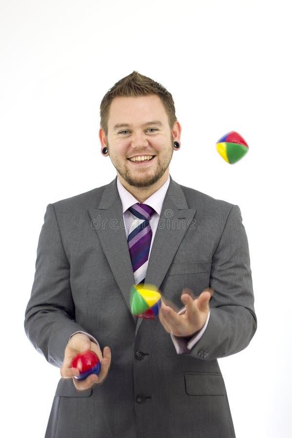 Juggler felice di affari fotografia stock libera da diritti