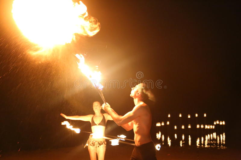 Juggler fire. Amazing fire show on the beach at the seaside royalty free stock images