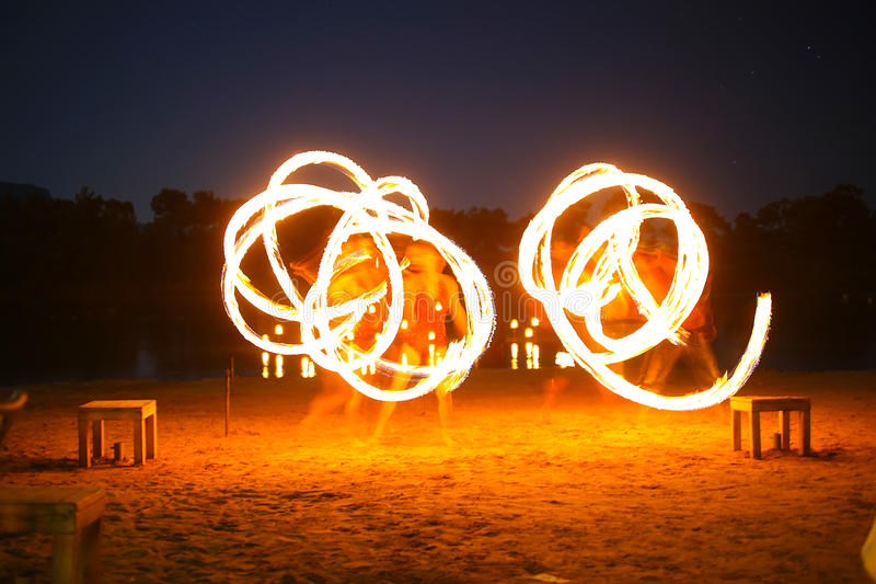Juggler fire. A native dancer with fire in the night time with motion blur royalty free stock photography