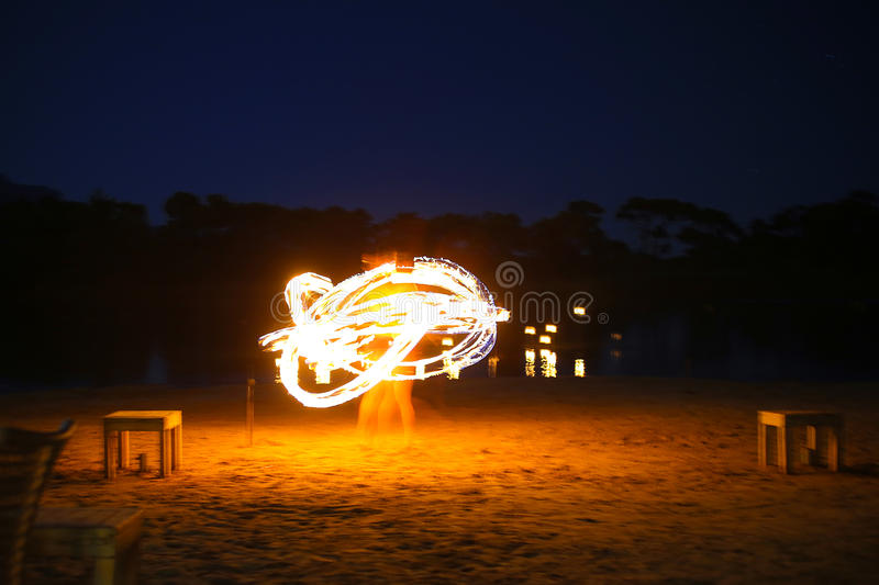 Juggler fire. A native dancer with fire in the night time with motion blur stock images