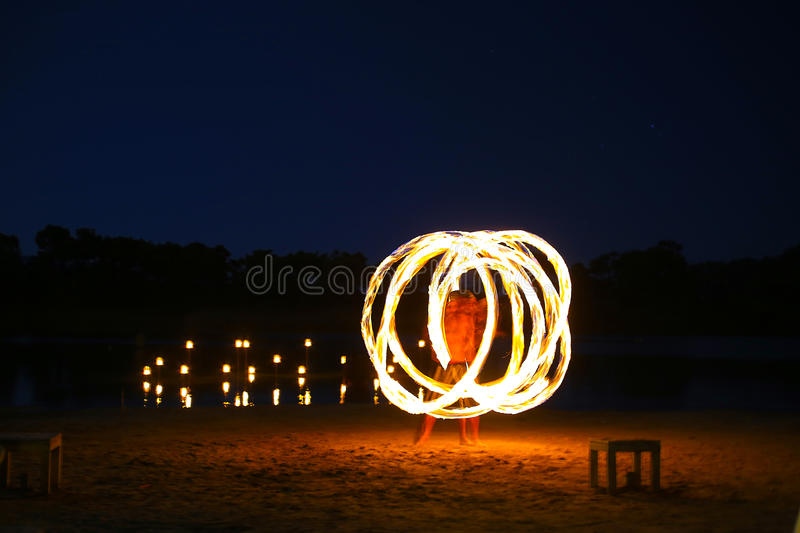 Juggler fire. A native dancer with fire in the night time with motion blur stock photo