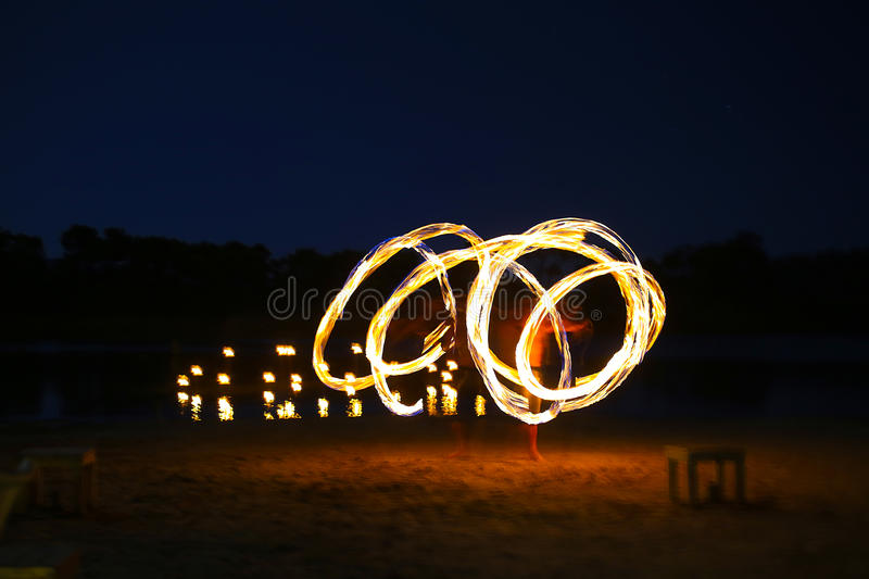Juggler fire. A native dancer with fire in the night time with motion blur royalty free stock images