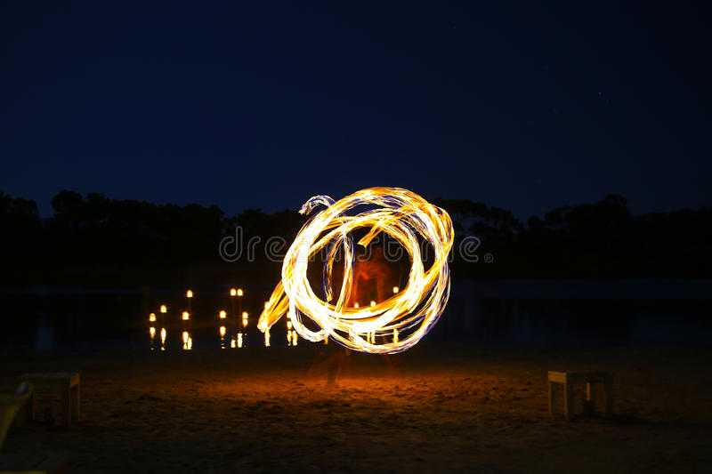 Juggler fire. A native dancer with fire in the night time with motion blur stock image