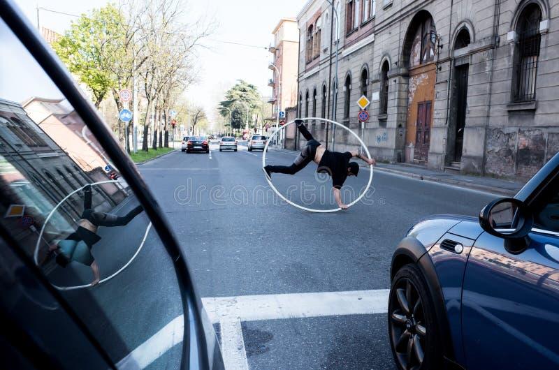 Juggler at the traffic light, Bologna, Italy stock photos