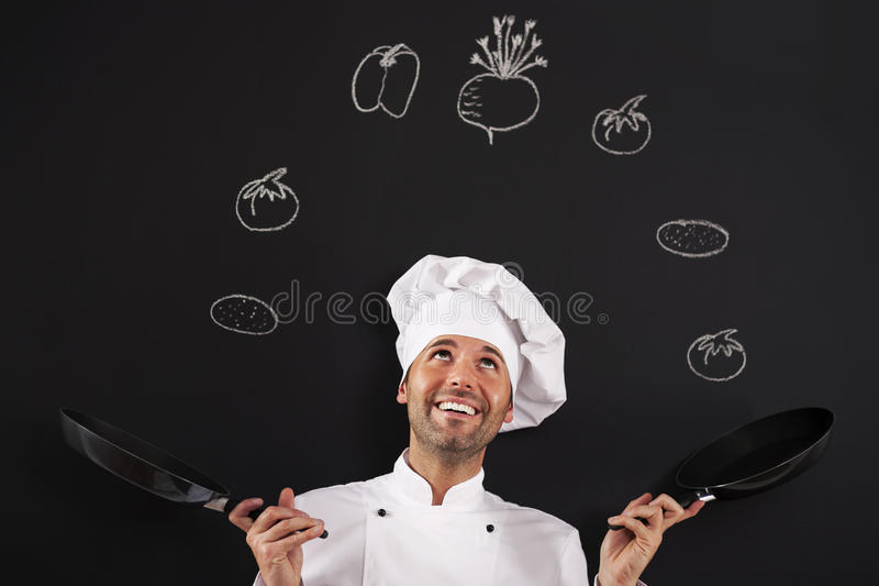 Jugglery mit Gemüse lizenzfreies stockfoto