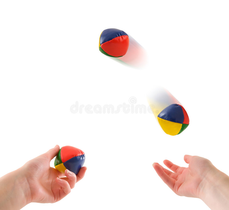 Juggling. Hands juggling three balls, isolated on white