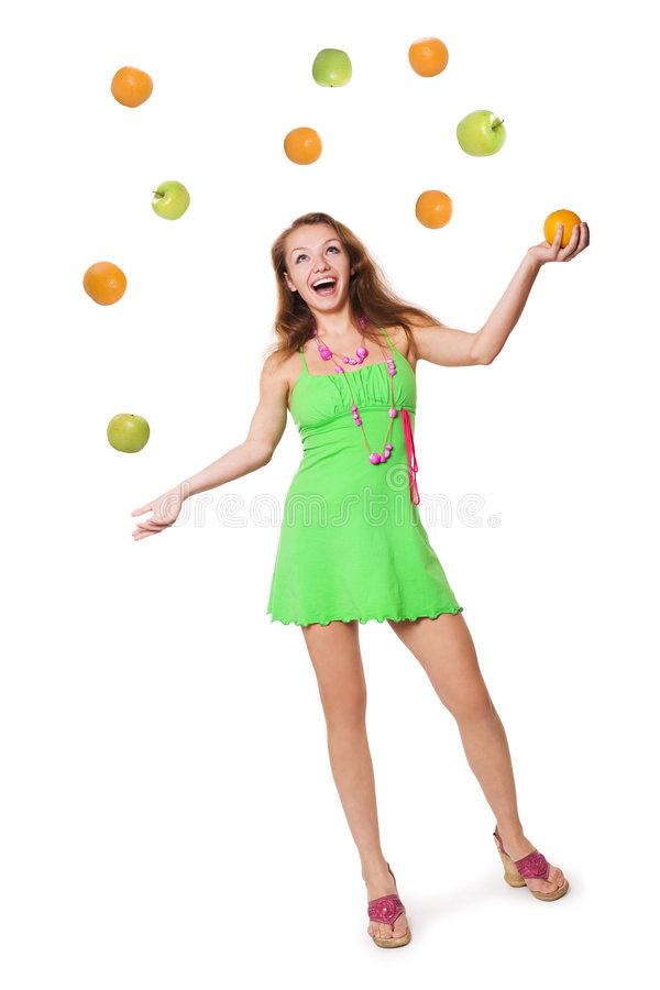 Juggling fruits royalty free stock photography