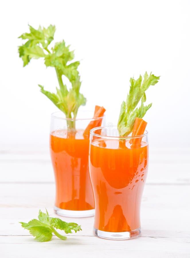Jugo de la zanahoria y de la calabaza foto de archivo