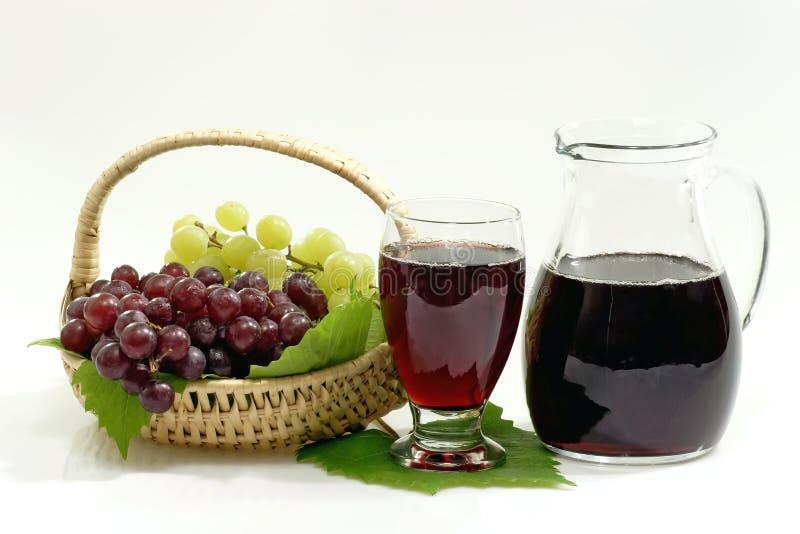 Jugo de uva roja imagenes de archivo