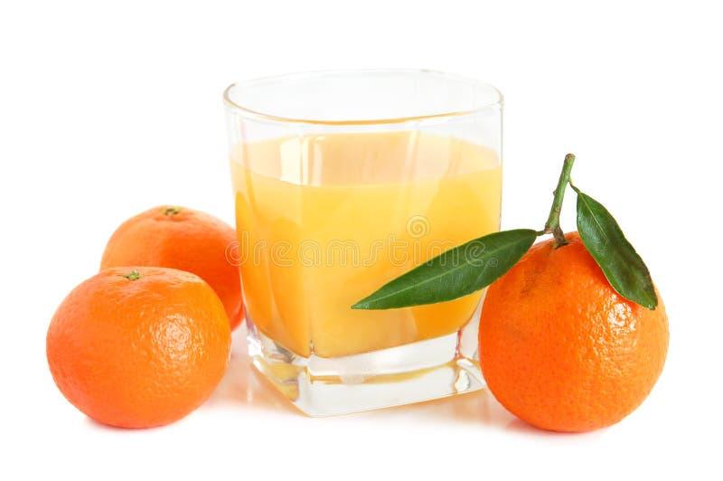 Jugo dulce de las mandarinas imagen de archivo