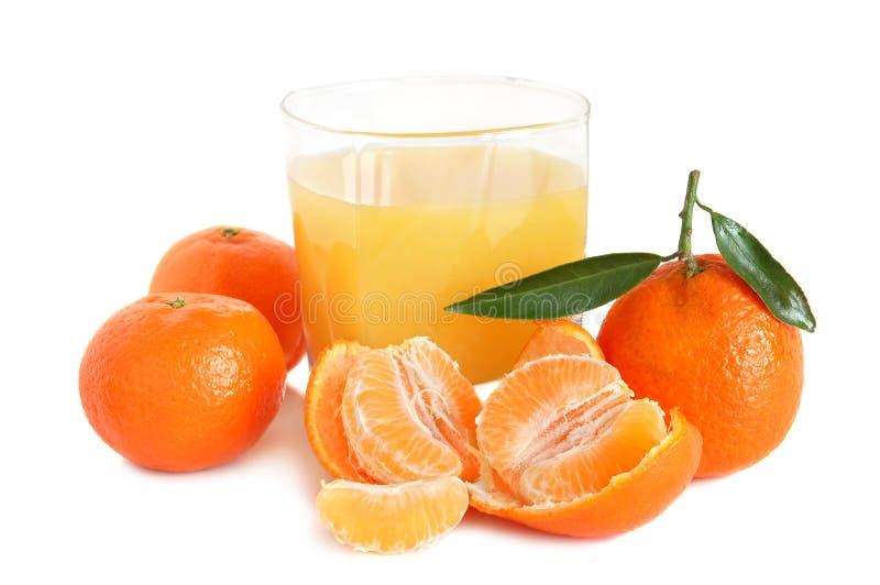 Jugo dulce de las mandarinas fotografía de archivo